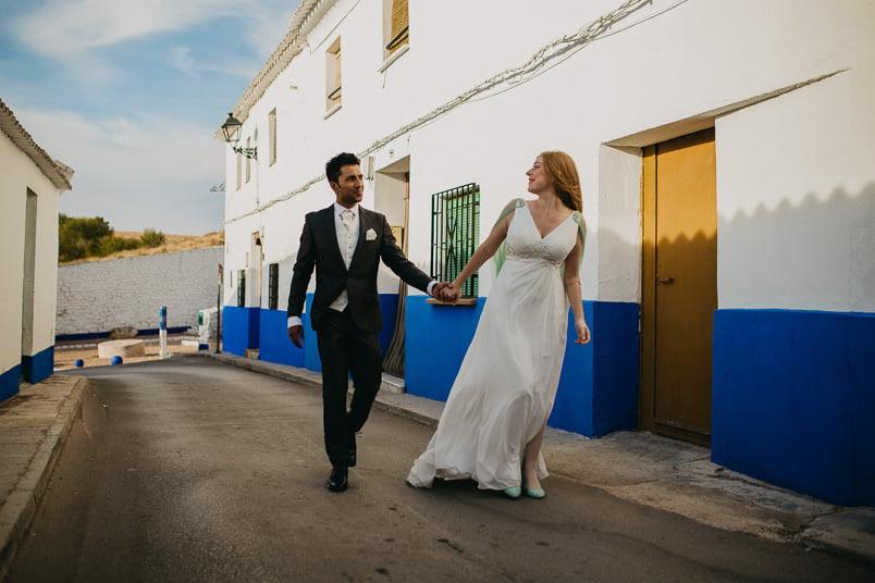 bride and groom walking in spain