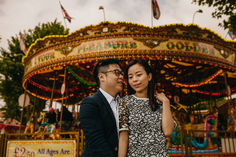 photo of couple in front of carousel