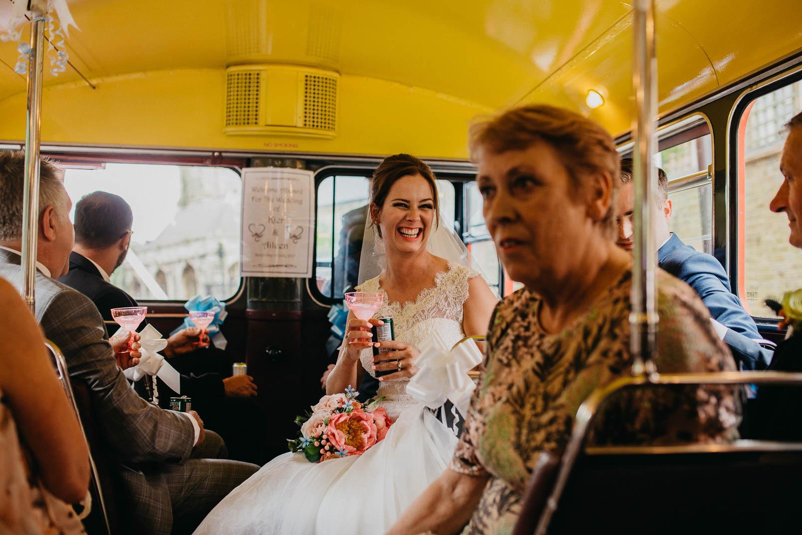 bride in wedding bus