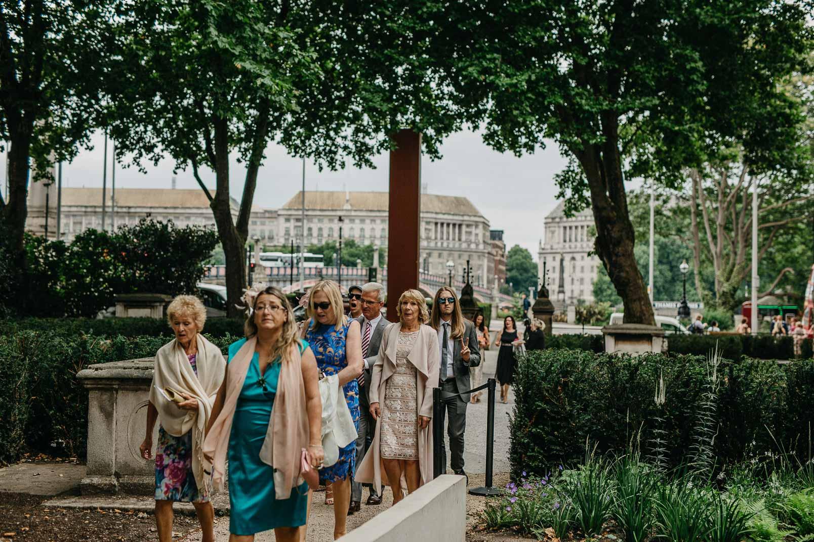 wedding guests arrive at garden museum
