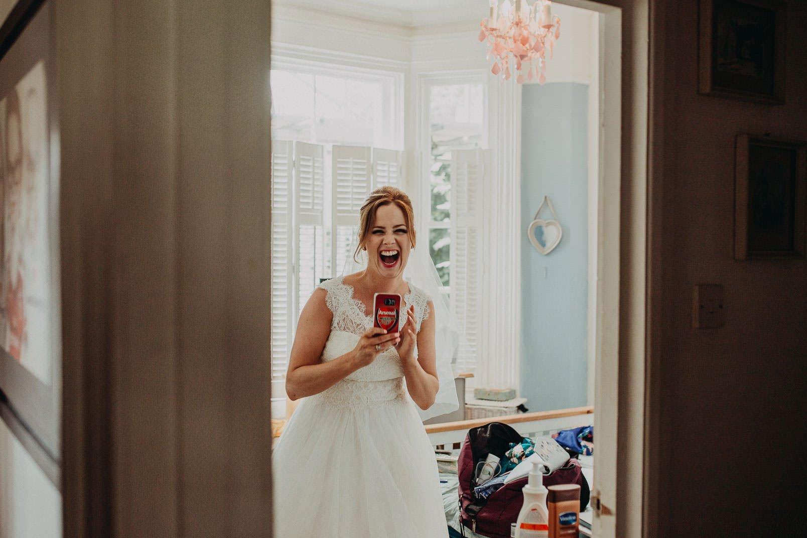 smiled bride in wedding dress