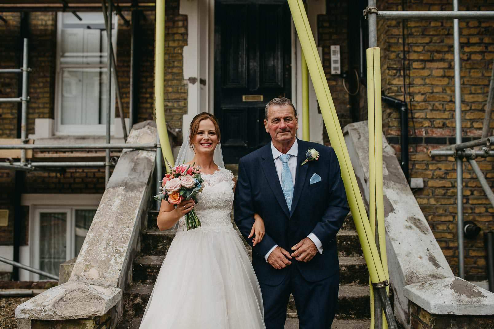 bride in wedding dress with father